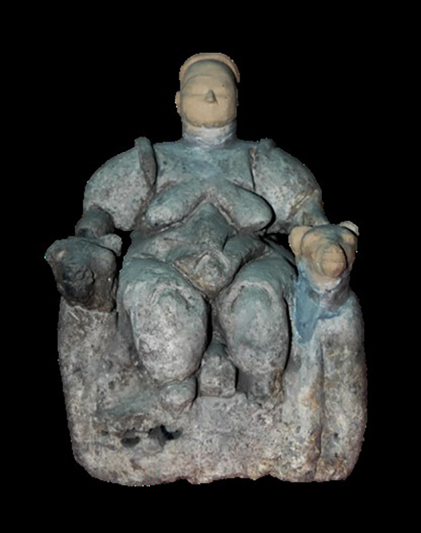 Photograph of female figurine, with missing parts reconstructed in clay, widely known as the 'Mother Goddess.'